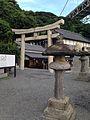 Stone lantern and torii of Mekari Shrine.jpg