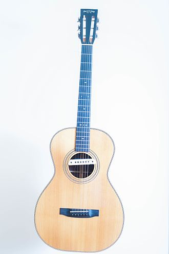 Acoustic-electric guitar - Acoustic-electric guitar with slotted headstock and an electric sound hole pickup.