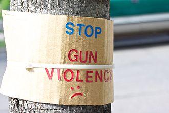 Gun violence - Image: Stop Gun Violence Sad Face Sign (4573522770)