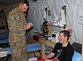 TF Patriot commander pins Purple Heart recipient DVIDS347564.jpg