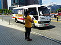 TIBS Shuttle Bus and Staff in Kaohsiung Exhibition Center 20140508.JPG