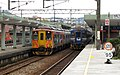 TRA DRC1034 and EMU510 at Ruifang Station 20130214.jpg