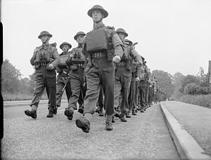 24th Infantry Brigade (United Kingdom) - Men of the 1st Battalion, Scots Guards, marching along St Pauls Cray Road near Chislehurst in Kent, 15 June 1942.