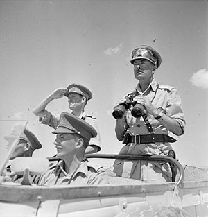 Harold Alexander, 1st Earl Alexander of Tunis - General Sir Harold Alexander, pictured here in August 1942 as Commander-in-Chief, Middle East, surveys the battlefront from an open car. To his right is Major General John Harding.