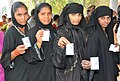 The Muslim women voters showing their voters identity card at a polling booth at Mylavaram, in Vijayawada, Andhra Pradesh, during the 2nd Phase of General Election-2009 on April 23, 2009.jpg