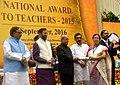 The President, Shri Pranab Mukherjee presenting the National Award for Teachers-2015 to Smt. Sapam Binodkumari Devi (Manipur), on the occasion of the 'Teachers Day', in New Delhi.jpg