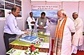 The Prime Minister, Shri Narendra Modi being briefed about the Projects under Namami Gange & National Highway projects, in Mokama, Bihar on October 14, 2017. The Chief Minister of Bihar, Shri Nitish Kumar is also seen.jpg
