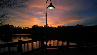 Florida Coastal School of Law - The sun setting on the lake behind FCSL