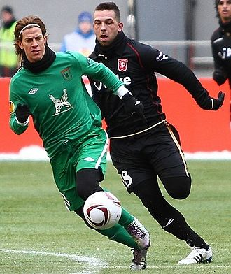 Theo Janssen - Janssen (right) with FC Twente against Rubin Kazan, February 2011.