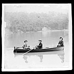 Three people in a rowing boat, possibly Sydney Harbour (7155341666).jpg