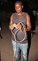Tribesman with a sling weapon in Gambia.jpg