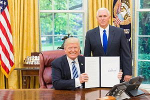 Presidential directive - President Donald Trump displaying Executive Order 13799