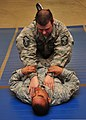 U.S. Air Force Master Sgt. Robert Reader, top, demonstrates a vascular choke on Staff Sgt. Jeffrey Johnson-Dean during an Air Force combatives class Jan. 10, 2014, at an undisclosed location in Southwest Asia 140110-F-XR500-253.jpg