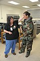 U.S. Air Force Senior Master Sgt. Kimberly Guidry, right, with the Air Force Personnel Center, tries on a chemical warfare suit with the help of Kezia Hillary, with the 902nd Logistics Readiness Squadron, to 110802-F-ZE476-114.jpg
