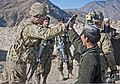 U.S. Army Sgt. Kyle Pratt, left, a team leader, from Bravo Team, 3rd Platoon, Alpha Troop, 1st Squadron, 40th Cavalry Regiment, Task Force Spartan, gives a local boy a high-five, during a mission with 120207-A-ZU930-014.jpg