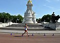 U.S. Army Staff Sgt. John Nunn, a racewalker with the U.S. Olympic Team, races past the Queen Victoria Memorial during the 50-kilometer race walk competition as part of the 2013 Olympic Games in London, United 120811-A-LX473-002.jpg
