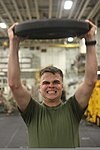 U.S. Marine Corps Lance Cpl. Kyle Taylor, with the command element of the 24th Marine Expeditionary Unit, participates in the combat conditioning portion the Warrior of the Month event in the hangar bay 120501-M-RO494-027.jpg