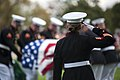 U.S. Marine Sgt. Katie Maynard salutes as a casket is lowered during a funeral ceremony at Arlington National Cemetery, Va., on 131024-M-FY706-201.jpg
