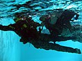 U.S. Marines practice water survival training in a swimming pool while in full battle dress at Combat Water Survival Swimming School in Camp Johnson, N.C., July 22, 2005 050722-M-FQ358-005.jpg
