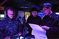 U.S. Navy Ensign Matthew Hein, left, tracks data with South Korean sailors in the combat operations center of the guided missile destroyer USS McCampbell (DDG 85) during Foal Eagle 2013 in the Yellow Sea 130316-N-TG831-155.jpg