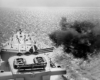 Blockade of Wonsan - USS Manchester firing her 6-inch guns at the Korean coast.