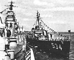 USS McCord (DD-534) alongside of USS Quincy (CA-71) in July 1952.jpg