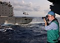 US Navy 020510-N-9610B-501 Navy Photographer documents a replenishment at sea.jpg