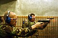 US Navy 030414-N-9849W-009 Master-at-Arms 1st Class John Mendonca from Honolulu, Hawaii, gets some target practice with a 9mm pistol at the Japanese Maritime Self Defense Force (JMSDF) indoor rifle range.jpg
