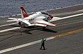 US Navy 030716-N-4757S-016 A T-45C Goshawk makes an arrested landing on the flight deck.jpg
