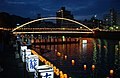 US Navy 030817-N-2420K-002 Illuminated by the Albuquerque Bridge, Japanese volunteers place candlelit lanterns into the Sasebo River during the city's annual Obon festival.jpg