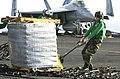 US Navy 030926-N-9319H-005 Storekeeper Seaman Jason Austin from Fayetteville, Ark., pulls a pallet jack.jpg