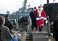 US Navy 031219-N-2903K-001 Santa Claus comes across the brow from the nuclear powered Los Angeles class attack submarine USS Jacksonville (SSN 699) after the submarine returned home to Naval Station Norfolk from a three-month d.jpg