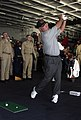US Navy 040303-N-5319A-007 Sailors watch professional golfer Mark O'Mara hit a few golf balls during a demonstration in the hanger bay of the nuclear powered aircraft carrier USS George Washington (CVN 73).jpg