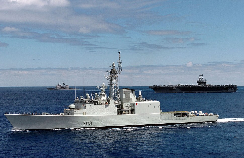 US Navy 040625-N-9769P-082 The Canadian destroyer HMCS Algonquin (DDG 283) is shown underway in close formation with the Nimitz-class aircraft carrier USS John C. Stennis (CVN 74) and the guided missile frigate USS Ford (FFG 54)
