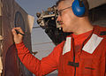 US Navy 041027-N-7568S-002 Gunner's Mate 2nd Class Christian Carrera tallies his score during a live-fire small arms qualification aboard the conventionally powered aircraft carrier USS John F. Kennedy (CV 67).jpg