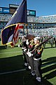 US Navy 041107-N-3312P-001 Sailors, assigned to the Pre-Commissioning Unit North Carolina (SSN 777), parade the colors at the Bank of America Stadium in Charlotte, N.C., as part of a Veteran's Day tribute during the Carolina Pa.jpg