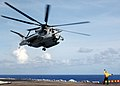 US Navy 050728-N-1941M-001 A Landing Signal Enlisted (LSE) guides a CH-53E Super Stallion helicopter to a landing.jpg