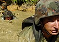 US Navy 050817-N-1261P-082 U.S. Navy Seabees low-crawl through mud-filled trenches during jungle warfare training.jpg