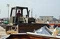US Navy 050905-N-4267W-019 A U.S. Navy equipment operator assigned to Naval Mobile Construction Battalion Seven (NMCB-7), clears debris at Jones Park in Gulfport, Miss.jpg