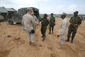 US Navy 060806-N-0411D-109 Kenyan Army Brig. Gen. and Natural Fire Commanding Officer, Leonard Ngondi, left, greets U.S. Marine Lt. Col. Steve Nichols, left, at Camp Lonestar