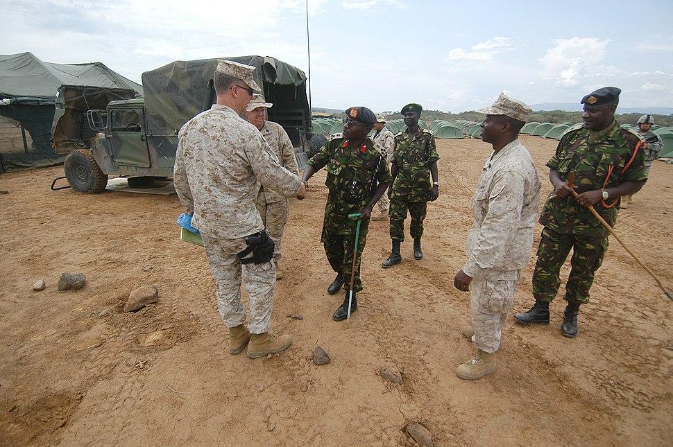 US Navy 060806-N-0411D-109 Kenyan Army Brig. Gen. and Natural Fire Commanding Officer, Leonard Ngondi, left, greets U.S. Marine Lt. Col. Steve Nichols, left, at Camp Lonestar
