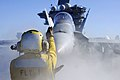US Navy 061201-N-8158F-147 viation Boatswain's Mate Handler Airman Sherard Bell directs an F-A-18 Hornet to catapult one prior to launch cycles on the flight deck aboard the nuclear-powered aircraft carrier USS Nimitz (CV.jpg