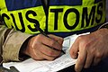 US Navy 061209-N-8148A-067 A customs border clearance agent assigned to Navy Customs Battalion Romeo keeps record of each inspection.jpg
