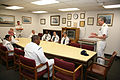 US Navy 070316-N-3271W-006 Commander, U.S. Second Fleet, Vice Adm. Evan M. Chanik visits with the Tucson Navy Operational Support Center staff during his visit as part of Tucson Navy Week.jpg