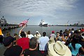 US Navy 070703-N-4515N-170 Family and friends of Sailors aboard guided-missile cruiser USS Vella Gulf (CG 72) watch as the ship pulls into port at Naval Station Norfolk after a six-month deployment as part of Bataan Expeditiona.jpg