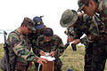 US Navy 070813-N-0989H-053 Guatemalan sailors and marines plot a course for a land navigation exercise during U.S. Marine Corps Small Unit Tactical training.jpg