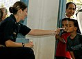 US Navy 070821-N-1467K-122 Lt. j.g. Natile Derfus, a nurse embarked aboard amphibious assault ship USS Peleliu (LHA 5), shows Micronesian children how to blow bubbles during a medical civic action program at the Tafunsak govern.jpg
