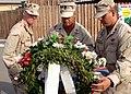 US Navy 070911-N-3285B-102 Capt. John Heckmann, commanding officer of Camp Lemonier, left, Electronics Technician 1st Class Arcenet Vazquez, and Hospital Corpsman 1st Class Eric Davenport lay a wreath in memory of the Sept. 11.jpg