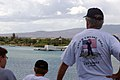 US Navy 070924-N-5148B-051 A father and his son look out at the USS Arizona Memorial as nuclear-powered aircraft carrier USS Nimitz (CVN 68) departs Pearl Harbor on a Tiger Cruise.jpg
