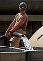 US Navy 071015-N-6889J-003 Equipment Operator Ryan Smith empties a water truck at Camp Shelby.jpg